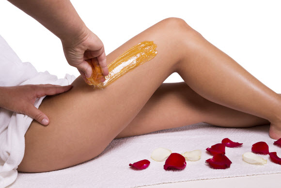 The Difference Between Waxing And Sugaring Body Hair Removal