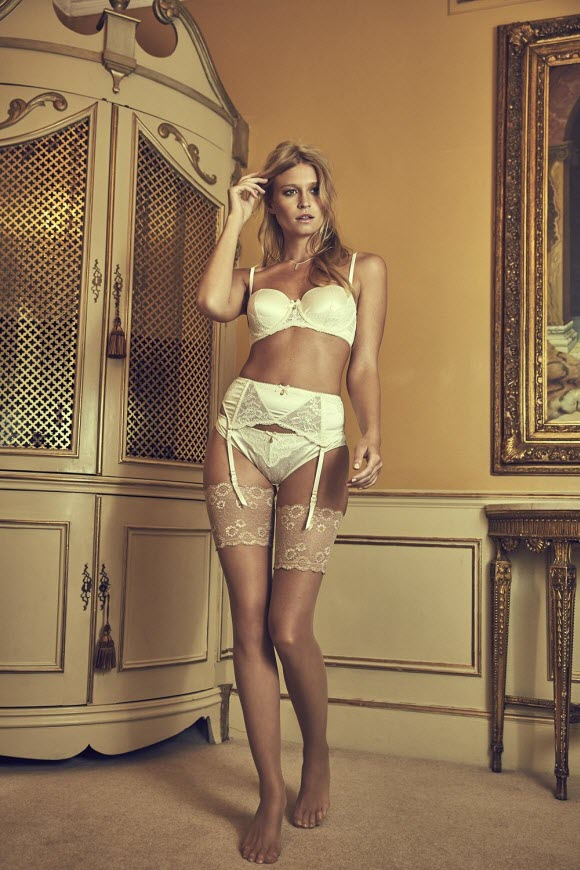Lace bra, suspender belt , and knickers ; nude stockings , Boux Avenue; necklace , New Look