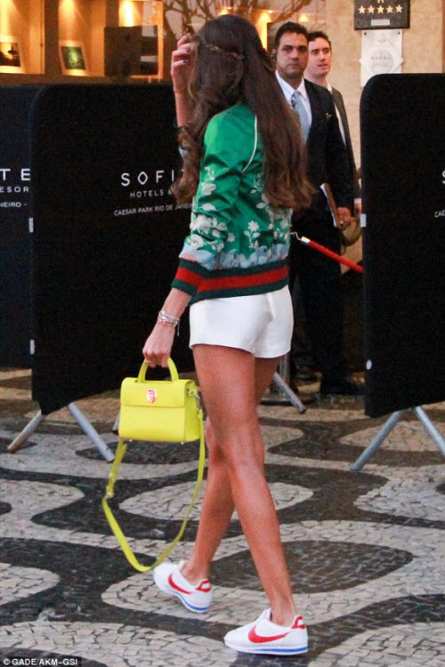 Izabel Goulart flashes midriff and endless legs in sporty crop top and shorts at Rio Olympics