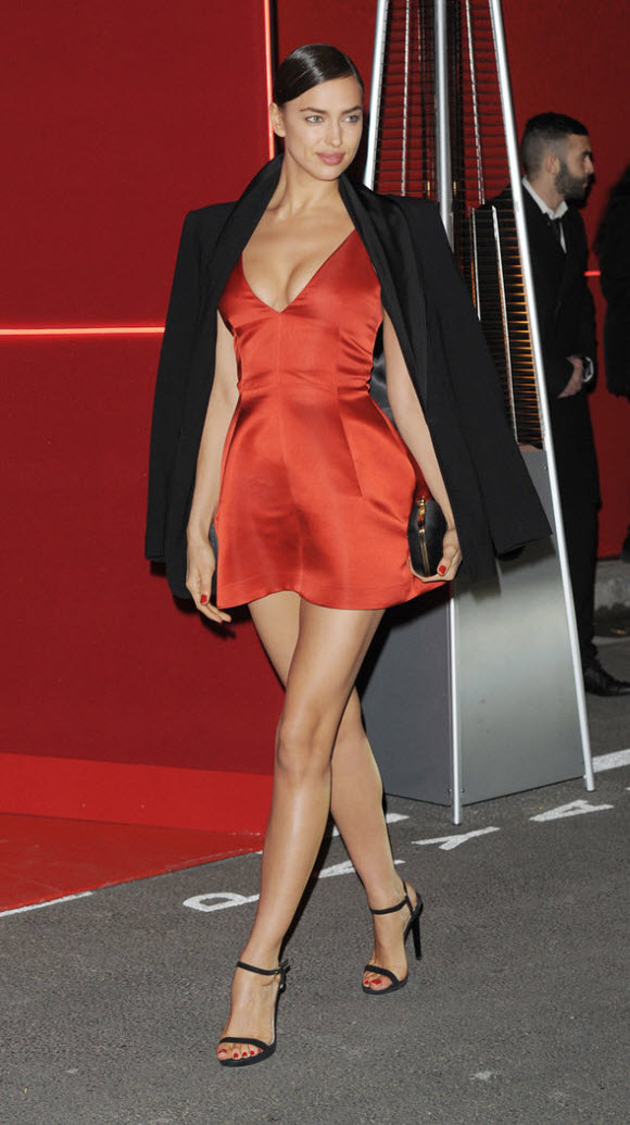 Irina flaunted her toned pins in a thigh-grazing red dress