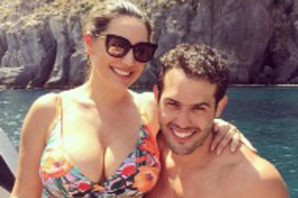 Kelly Brook puts on an eye-popping display as her swimsuit struggles to contain her cleavage