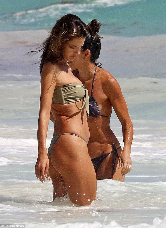 Victoria's Secret angel Alessandra Ambrosio turned heads while lounging on a beach with her friends in Tulum, Mexico, on Friday.