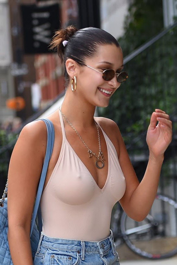 Feeling nippy? Bella Hadid Goes Braless While Shopping In Plunging Nude Colored Top