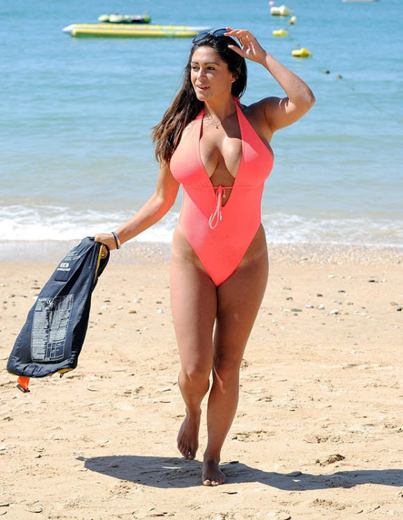 Casey Batchelor Showcased Her Incredible Curves In Hot Orange Swimsuite