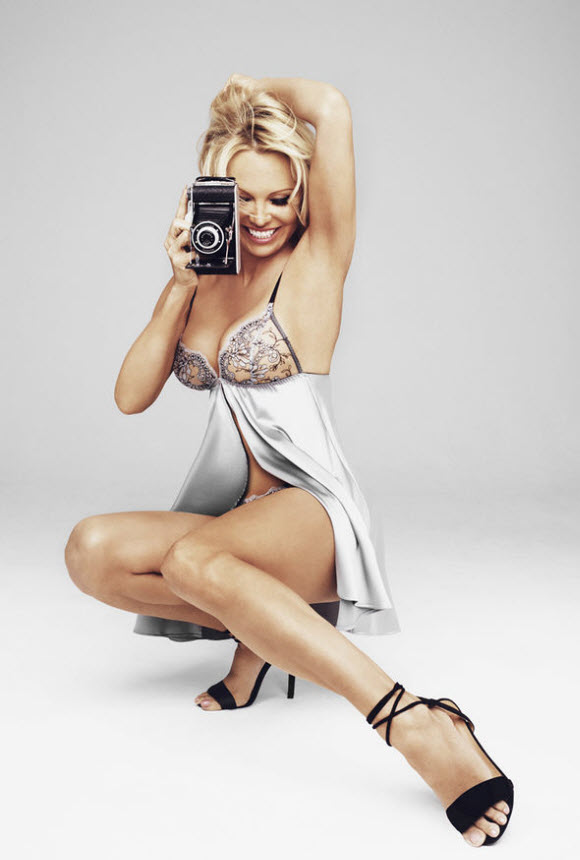 Pamela Anderson Flaunts Her Breasts As She Strips Topless And Displays Bottom In Sexy Lingerie